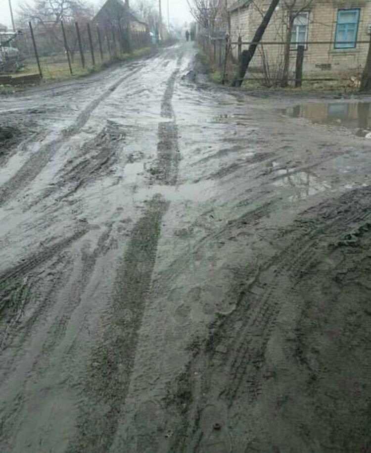 В Мелитополе дорога в частном секторе превратилась в болото , фото-1